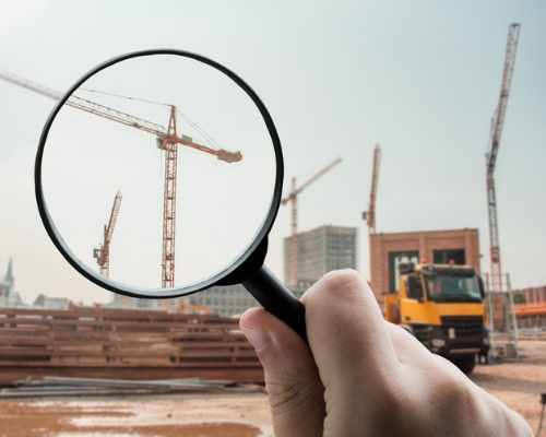 Magnifying Glass Being Held Over Construction Crane