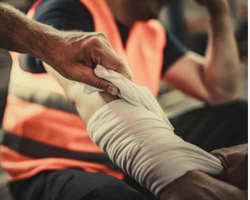Injured Arm Being Bandaged