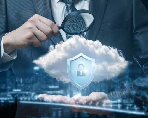 Man Holding Magnifying Glass and Looking at Clouds and Lock