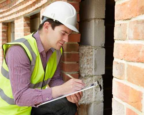Contractors writing down information on a piece of paper.