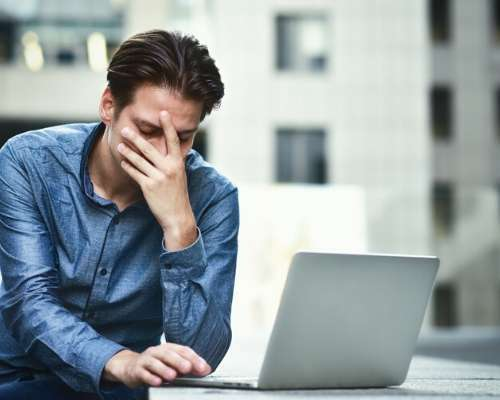 Man Struggling While on the Computer
